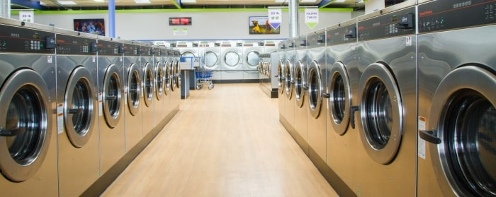 inside-facing-laundry-machines-in-isle